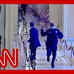 Jake Tapper reacts to video of officer rushing Mitt Romney to safety